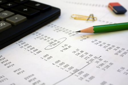 scrutiny: The calculator, pencil lay on the financial report. One number is led round.
