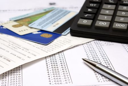 Heap of bills and checks, credit cards, the calculator, a ball pen. Reklamní fotografie - 4229528