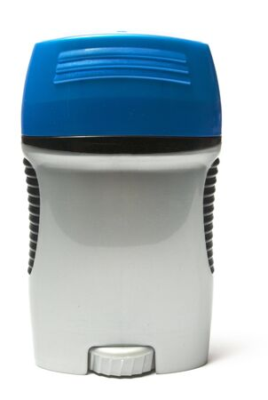 plastic container of deodorant with a blue lid shot on white