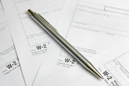 Business metal pen  on W-2 tax form Stock Photo