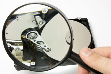 open Hard Drive with magnifying glass on white