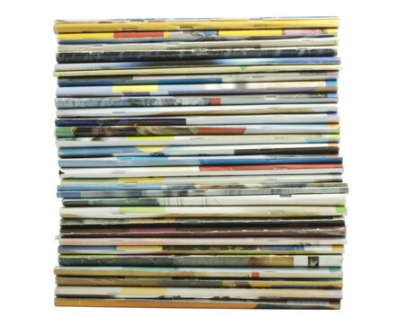 Heap of multi-coloured old magazines on a white background it is isolated