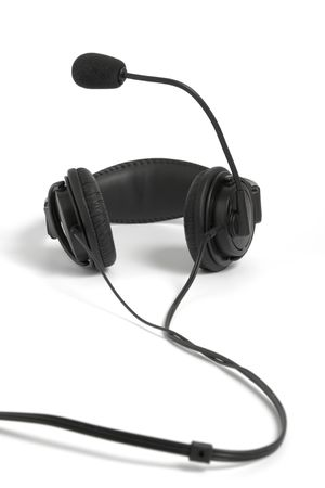 aural: Black headphone with microphone on white background Stock Photo