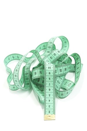 green tape measure isolated on white background photo