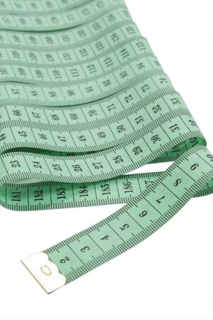 green tape measure isolated on white with pach photo
