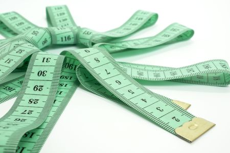 green tape measure on white background in the form of a star photo