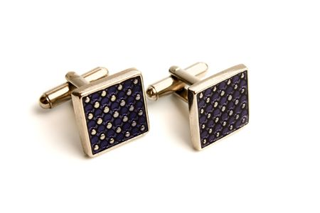a pair of stainless steel cufflinks on white