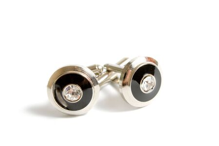 cuff link: a pair of stainless steel cufflinks on white