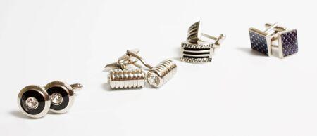 cufflinks: set of stainless steel cufflinks on white