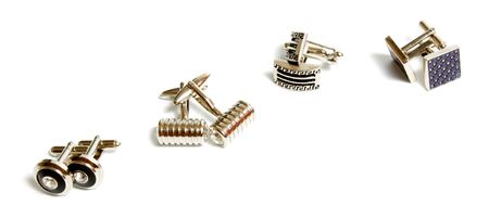 cufflinks: set of stainless steel cufflinks isolated on white background