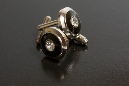 stainless steel cufflinks on the black background Stock Photo - 6055053