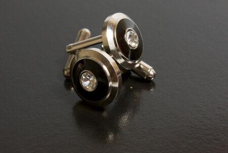 cufflinks: stainless steel cufflinks on the black background