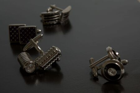 cuff link: stainless steel cufflinks on the black background