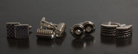 stainless steel cufflinks on the black background