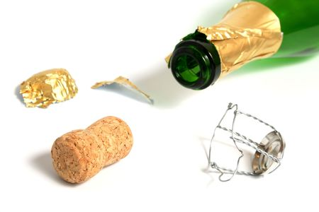 open empty champagne bottle and Cork isolated on white Reklamní fotografie