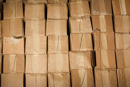 Old dirty cardboard boxes in a warehouse. Contept of obstacle in business, the stale goods. photo