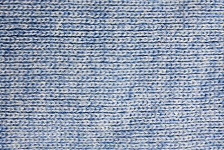 Background of the blue knitted fabric detail photo