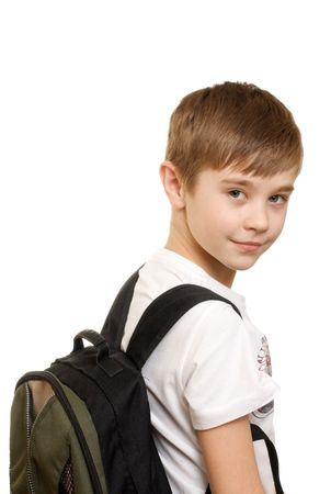 10 years old boy with a backpack isolated on white background photo