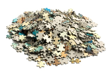 unsolved: unsolved bunch of jigsaw puzzles pieces isolated on white