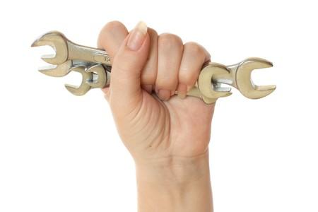 female hand holding wrench tools isolated on white background photo