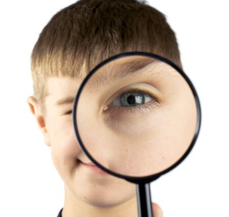 schoolkid search: Kid using magnifying glass isolated on white background