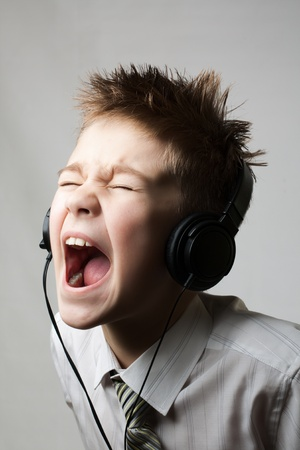 Ten year young child screaming with angry face expression isolated on white