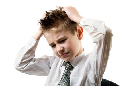 upset boy in a shirt and tie, holding his hands behind his head isolated on white Stock Photo - 8292837