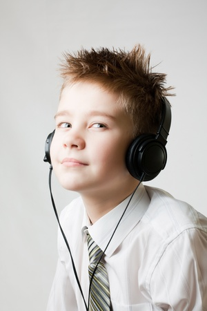 portrait of young boy listening to head phones photo
