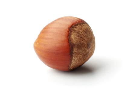 vitamines: macro picture of the hazelnut in white background