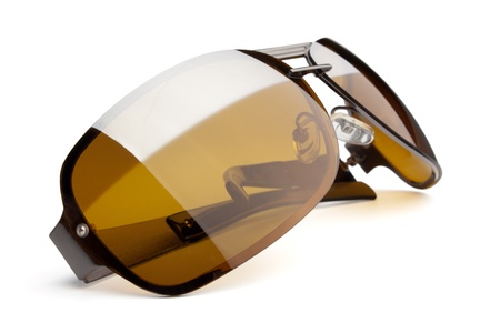 A pair of brown sunglasses on a white background. Clipping path is included
