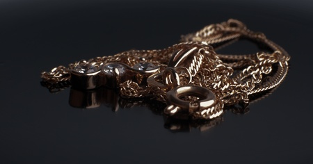 gold chain with a pendant on a black