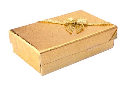 Gift box with golden surface and shiny ribbon. Isolated white background. photo