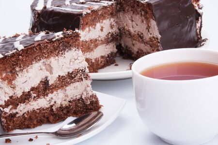 the chocolate cake and cup of tea photo