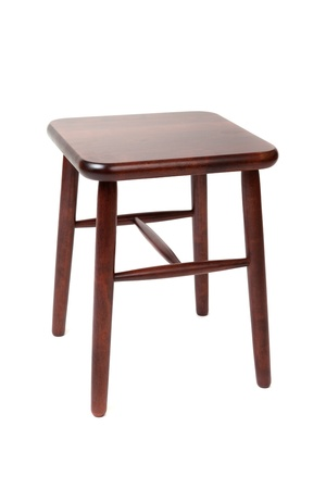 Brown wooden stool with four legs isolated on white