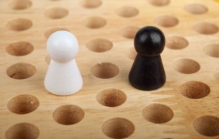 A pair of figures on the board  The concept of cooperation or competition  photo