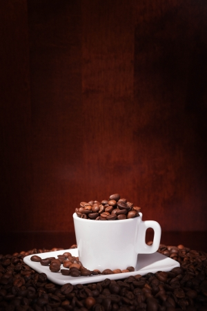 cup with coffee beans on a dark background Stock Photo - 17585376