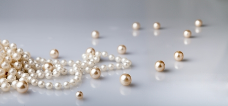 pearl beads and pearls with reflection on gray  Stock Photo
