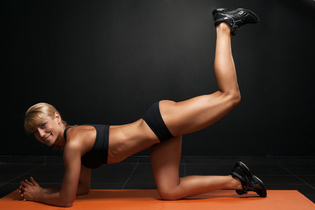 beautiful woman doing exercises on the floor