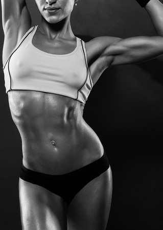 motivate: attractive fitness woman, trained female body, lifestyle portrait, caucasian model Stock Photo