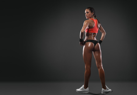 athletic body: Athletic young woman showing muscles of the back