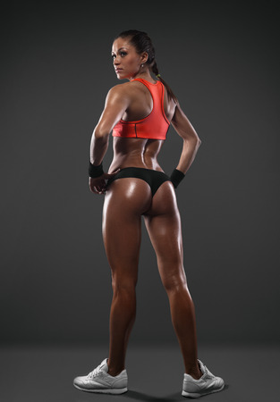 showing muscles: Athletic young woman showing muscles of the back