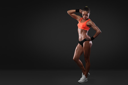 studio model: sports woman portrait wearing sportswear isolated with clipping path