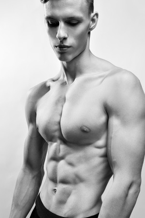 abdominal muscles: handsome young man with a muscular torso and abdominal muscles