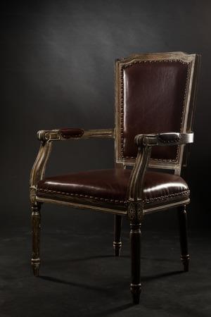 old furniture: Dark genuine leather vintage chair. Old vintage furniture. Stock Photo