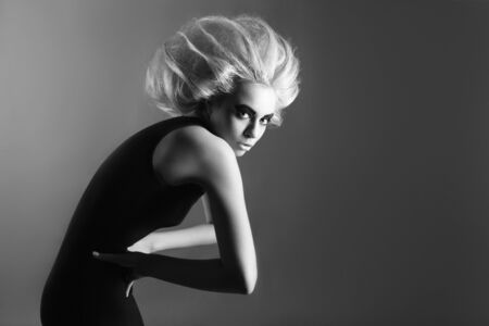 vogue style: Updo. Vogue Style. Woman with Futuristic Hairdo. Black and white photo. Stop hand gesture.