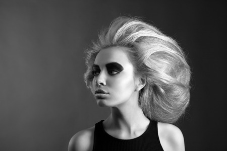 updo: Updo Vogue Style. Woman with Futuristic Hairdo. Stop hand gesture.