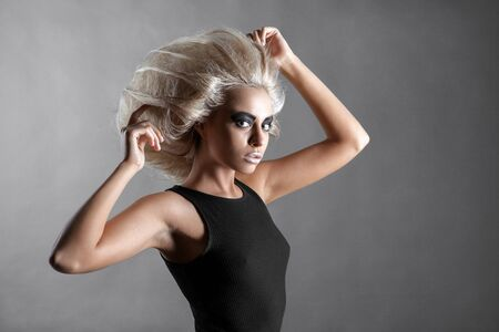 updo: Updo Vogue Style. Woman with Futuristic Hairdo. Fashion. Hairstyle