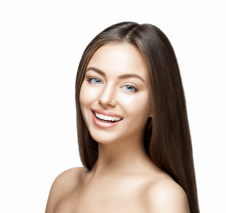 Portrait of attractive caucasian smiling woman brunette on gray background, studio shot toothy smile face long hair head and shoulders Stock Photo