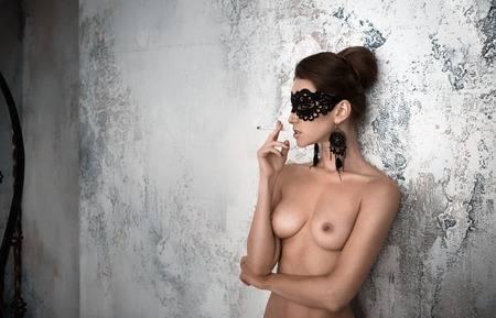 beautiful sexy woman topless takes a milk bath Stock Photo