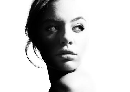 High contrast black and white portrait of a beautiful girl. Archivio Fotografico